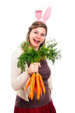 Funny woman with bunny ears holding carrots Stock Photography