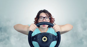 Funny woman with car wheel and smoke Royalty Free Stock Photography
