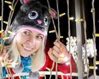 Funny woman with cat winter hat posing Outdoor Christmas decorations Stock Image