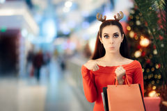 Funny Woman with Christmas Reindeer Horns Headband Shopping Royalty Free Stock Photos