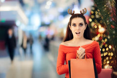 Funny Woman with Christmas Reindeer Horns Headband Shopping Royalty Free Stock Images