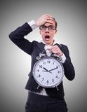 Funny woman with clock on the white Royalty Free Stock Photo
