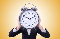 Funny woman with clock on the white Stock Photos