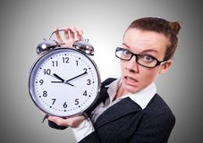 Funny woman with clock on the white Royalty Free Stock Photos