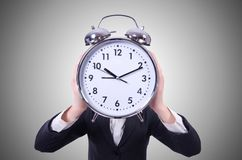 Funny woman with clock on the white Stock Image
