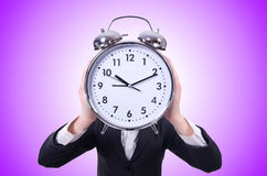 Funny woman with clock on white Stock Image