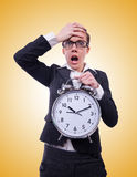 Funny woman with clock on white Stock Images