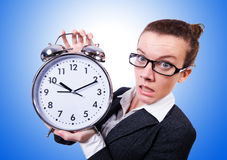 Funny woman with clock on white Royalty Free Stock Photography