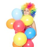 Funny woman with colorful balloons over white Stock Photo