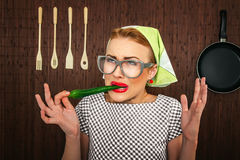 Funny woman cook. With hot pepper-close up Stock Image