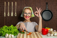 Funny woman cook. Happy woman cook with okay sign cut carrot-vintage concept Stock Images