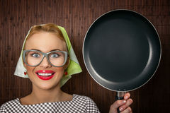Funny woman cook. Close-up funny woman cook with pan - vintage concept Royalty Free Stock Image