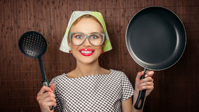 Funny woman cook. Close-up funny woman cook with pan and spoon - vintage concept Stock Photo