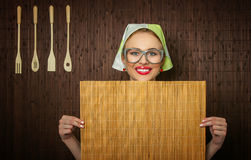 Funny woman cook. Funny rural woman cook holdin ledle and chopping shim, space for your text Stock Photo