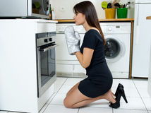 Funny woman cooking Royalty Free Stock Image