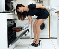 Funny woman cooking Stock Photography