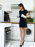 Funny woman cooking Stock Photos
