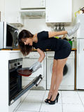 Funny woman cooking chocolate cake Stock Photo