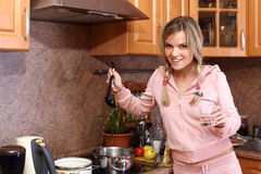 Funny woman cooking dinner Stock Photo