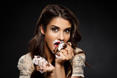 Funny woman in creamy dress holding piece of cake Royalty Free Stock Image