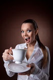 Funny Woman with cup of coffee smile at brown. Funny beauty woman with cup of coffee smile at brown background Stock Images