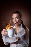 Funny Woman with cup and splash of tea smile Royalty Free Stock Photo