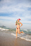 Funny Woman Dancing On The Beach. Christimas Collection Royalty Free Stock Image
