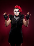 Funny woman in day of the dead mask smile on red Stock Photography