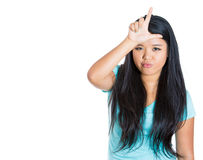 Funny woman displaying a loser sign on her forehead Royalty Free Stock Photos