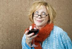 Funny Woman Drinking Wine. Woman with a big grin drinking red wine Royalty Free Stock Images