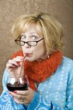Funny Woman Drinking Wine Stock Photo