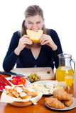 Funny woman eating cheese Stock Photos