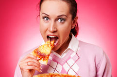 Funny woman eating pizza Royalty Free Stock Image