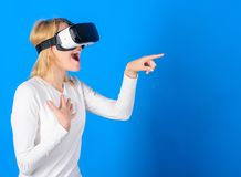 Funny woman experiencing 3D gadget technology - close up. Excited smiling businesswoman wearing virtual reality glasses. Person with virtual reality helmet royalty free stock photography
