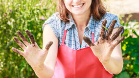 Funny woman farmer showing dirty hands Royalty Free Stock Image