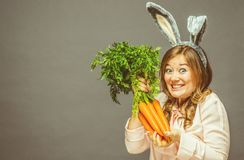 Funny woman with fresh carrot. Picture with space for your text.  royalty free stock images
