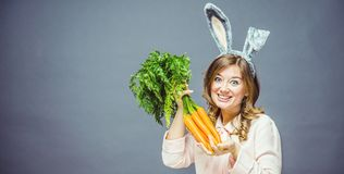Funny woman with fresh carrot. Picture with space for your text.  stock images