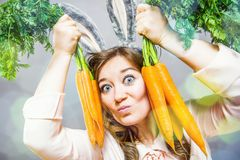 Funny woman with fresh carrot. Picture with space for your text royalty free stock photography