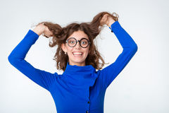 Funny woman in glasses looking at camera Stock Image