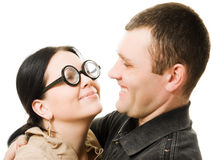 Funny woman in glasses and man. Funny women in glasses and men on a white background Stock Photography