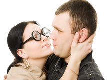 Funny woman in glasses wants to kiss a man Royalty Free Stock Photos
