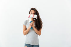Funny woman hiding her face with brush and paint roller Royalty Free Stock Photography
