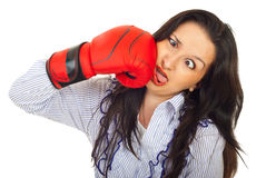 Funny woman hit itself. Funny business woman hot itself with a boxing glove and making a face isolated on white background stock image
