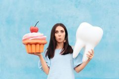 Funny Woman Holding Big Cupcake and Tooth. Girl having dental problems after eating too much sugar royalty free stock photography