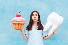 Funny Woman Holding Big Cupcake and Tooth. Girl having dental problems after eating too much sugar stock photos
