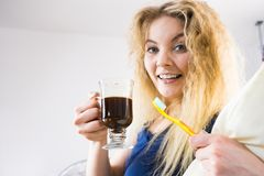 Funny woman being late drinking coffee Royalty Free Stock Image