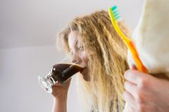 Funny woman being late drinking coffee Royalty Free Stock Photography