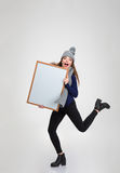 Funny woman holding blank board Stock Photography
