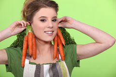 Funny woman holding carrots Stock Photo