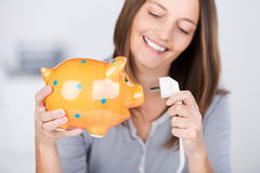 Funny Woman Holding Electric Plug And Piggy Bank Stock Photos